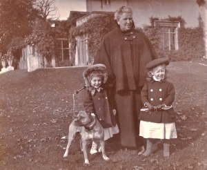 The three-year-old cousins, Irene Phipps-Hornby (left) and Valerie Jay (right) shown in the grounds of Blendon in 1898, accompanied by their nurse